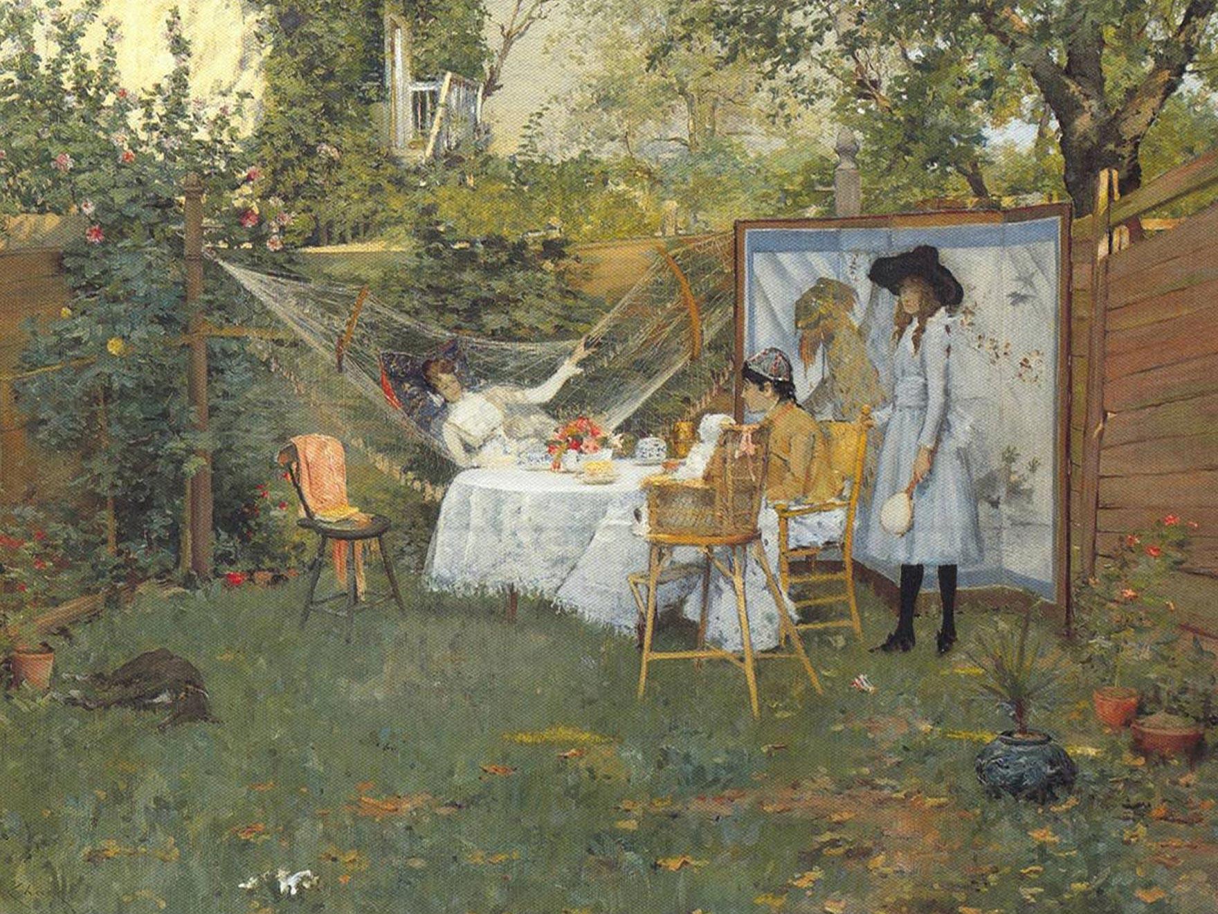 Family in backyard enjoying breakfast