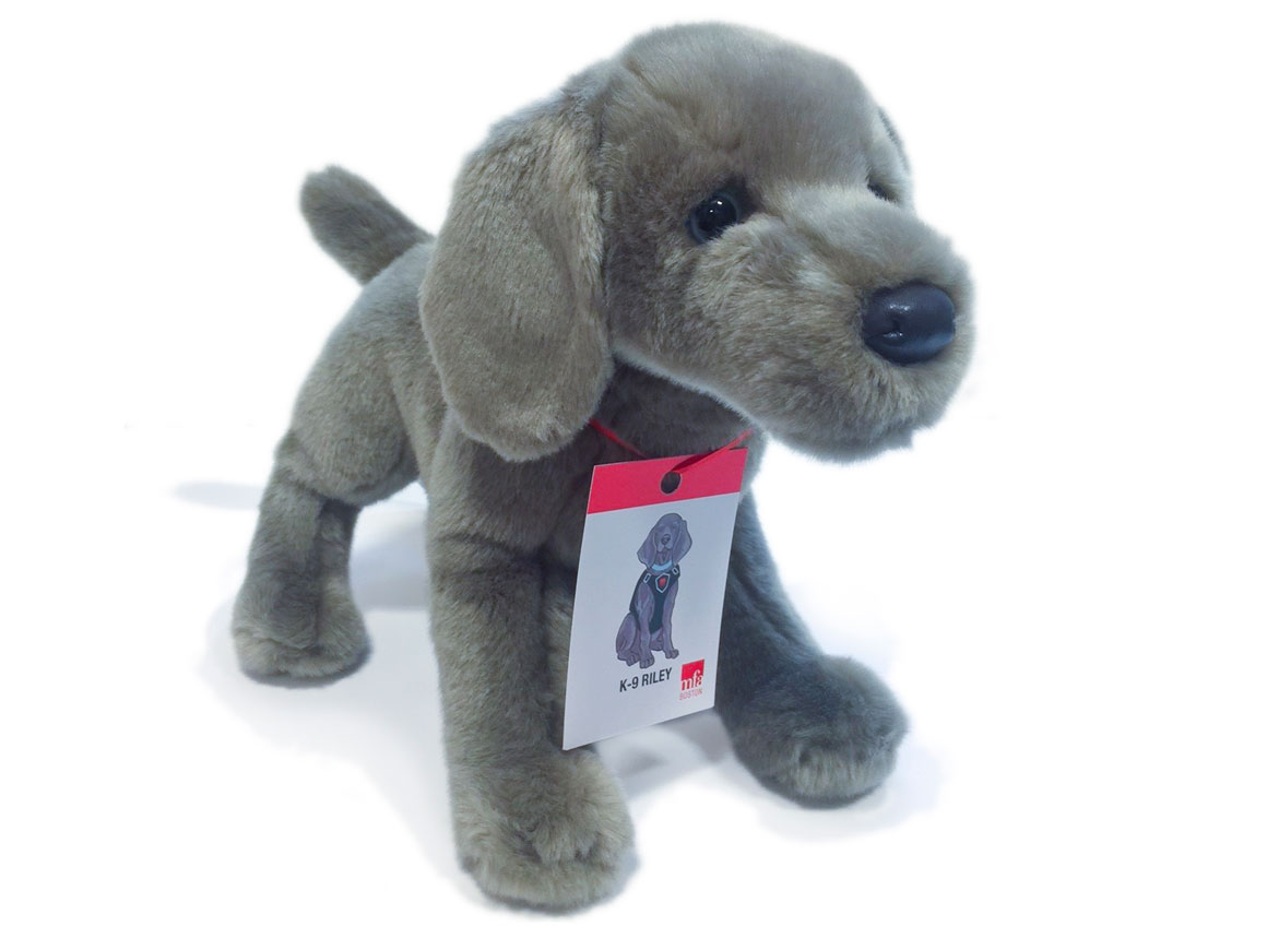 Stuffed dog in the resemblence of Riley, with ID badge around neck