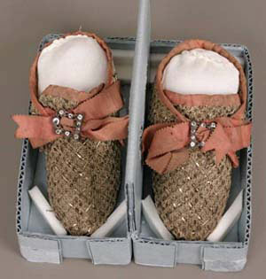 Pair of children's shoes, French, possibly 17th century, Linen and gilt metal thread passementerie and linen plain weave lining, with silk gross grain ribbon, diamond paste stones and metal, and leather heel, sole and inner lining, 6.5 x 6.5 x 13.4 cm (2 9/16 x 2 9/16 x 5 1/4 in.), Gift of Philip Lehman in memory of his wife Carrie L. Lehman, 38.1363a-b.
