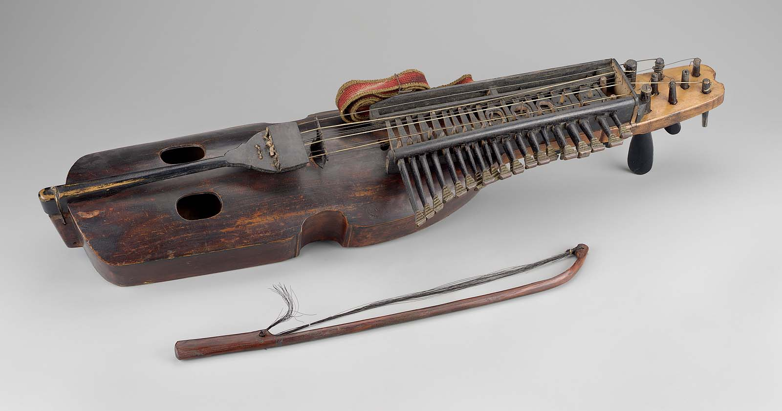 Keyed fiddle (nyckelharpa) and bow