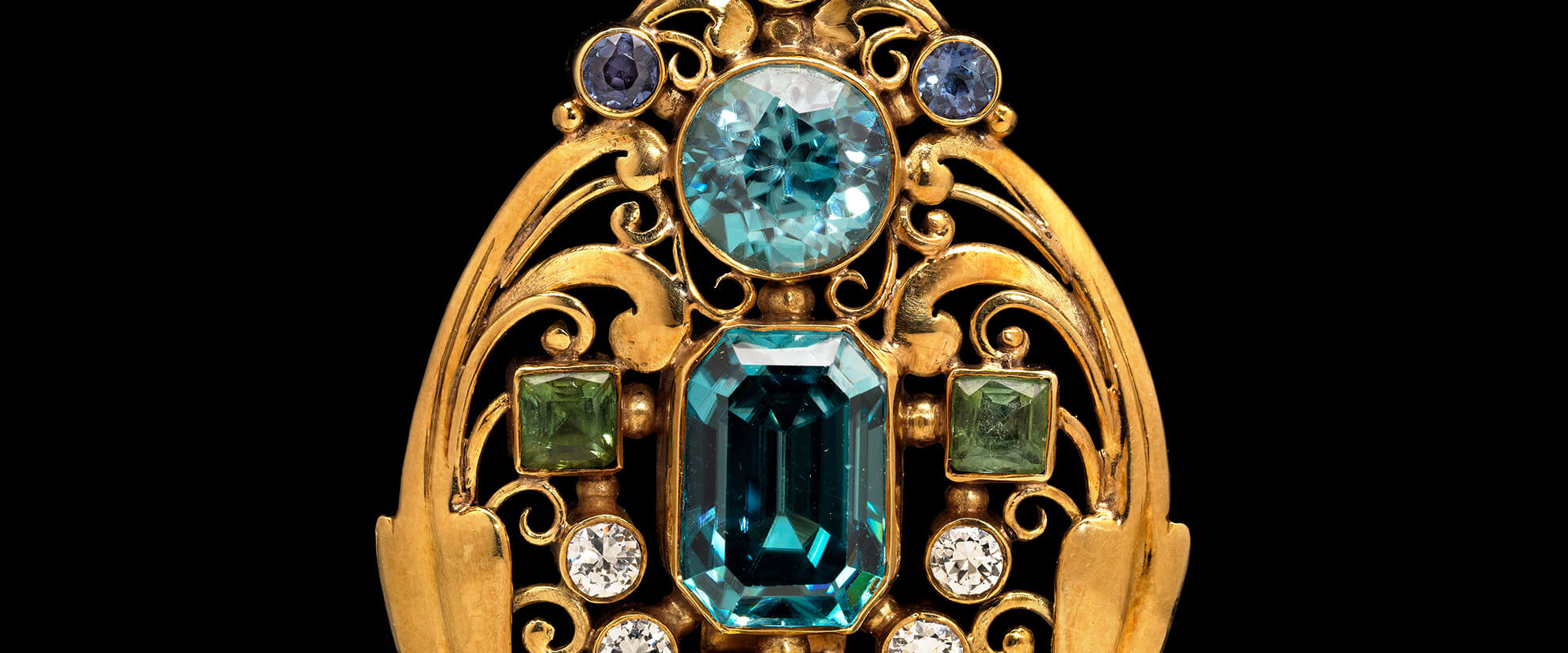 Detail of jeweled scroll brooch, made by Frank Gardner Hale