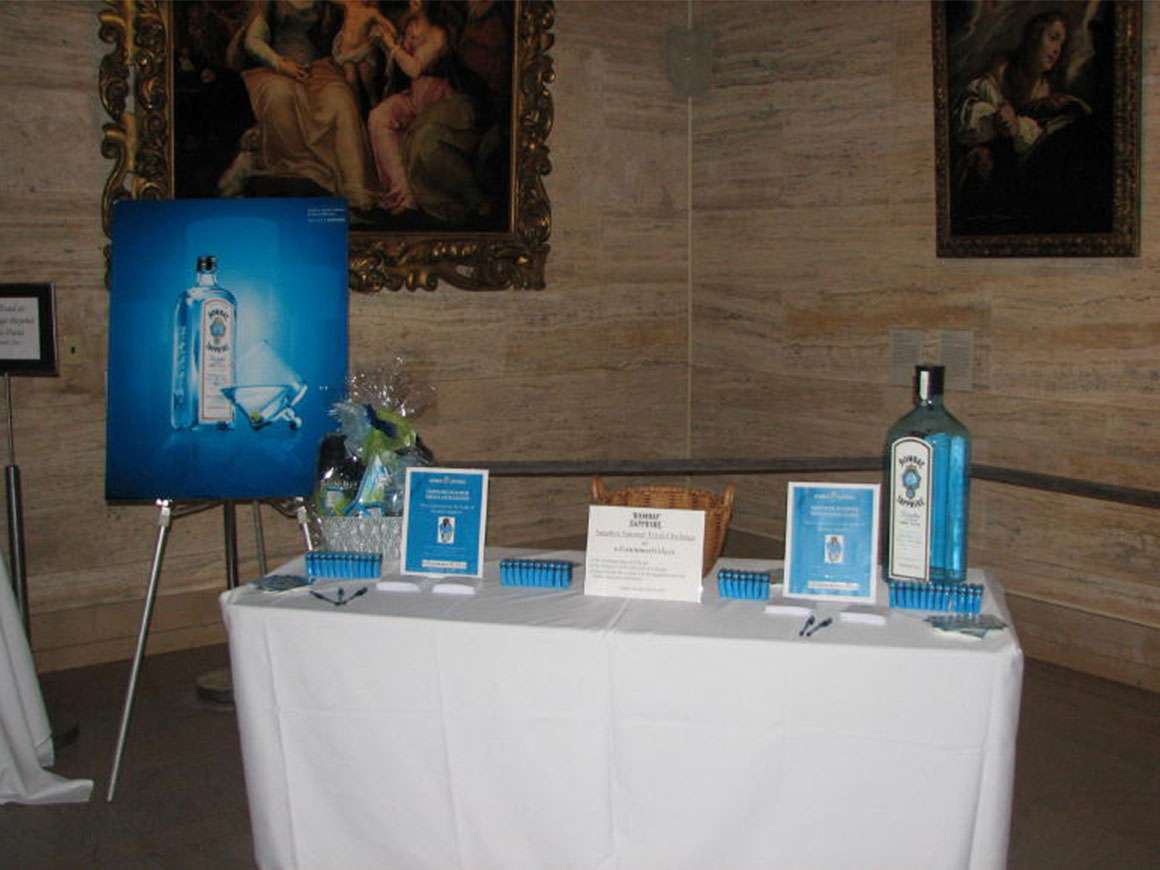 Table in Koch Gallery set up with Bombay Sapphire signage and swag