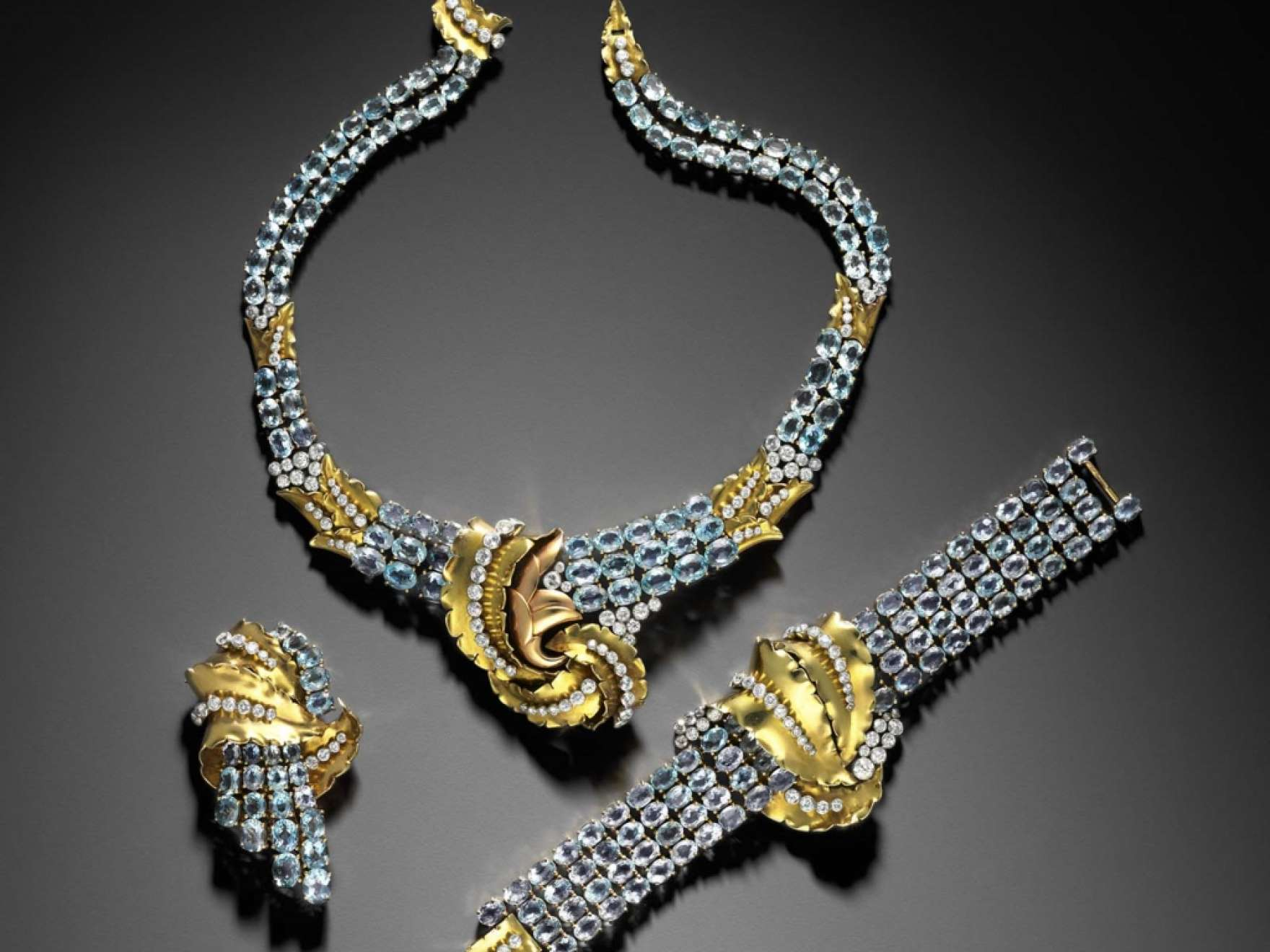 Brooch, necklace and bracelet in Gold, diamond, and aquamarine made by Verger Freres and worn by Joan Crawford