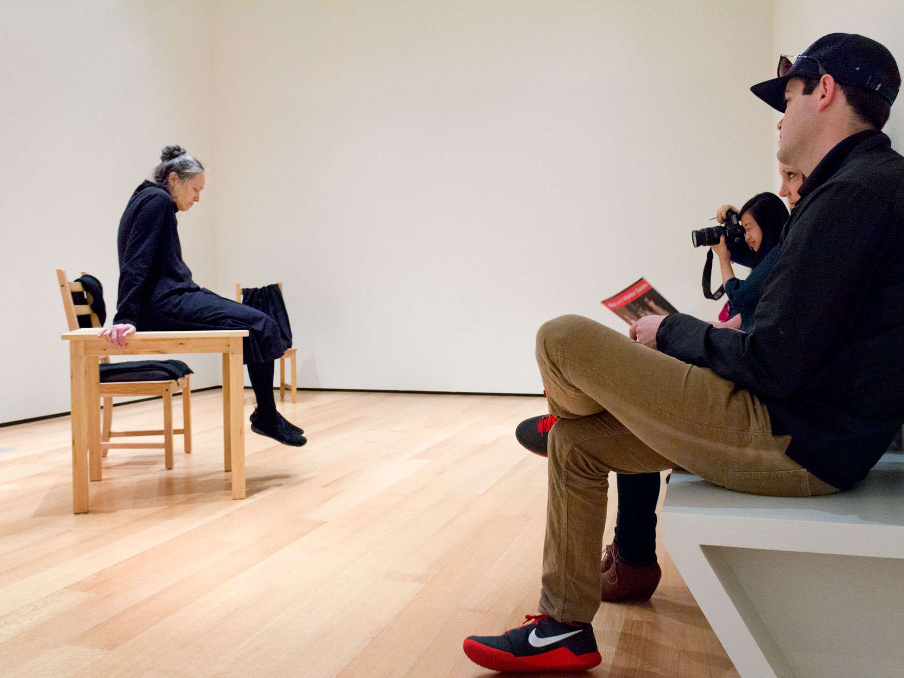 Visitors sitting on bench watching Marilyn Arsem perform in 100 Ways to Consider Time, November 2015