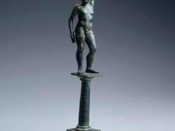 Support for a stand in the shape of a discus thrower (diskobolos)