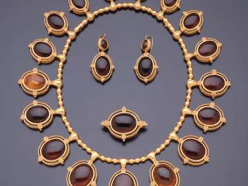 Demi-parure, comprising a necklace, brooch, and pair of earrings
