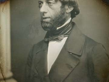 Portrait of a Bearded Man in Three-quarter Profile Standing next to a Column
