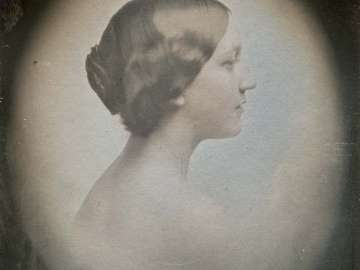 Woman in Profile, Looking Right, in Oval Vignette