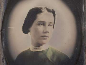 Young Woman in Green Dress and High White Collar, in Oval Vignette