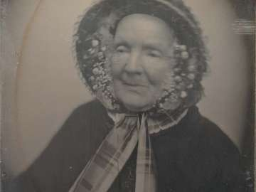 Older Woman, in Bonnet Lined with Tiny Flowers