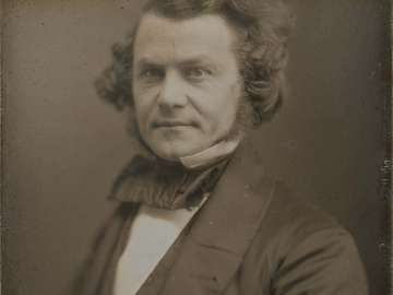 Man with Curly Hair and Large Bow Tie