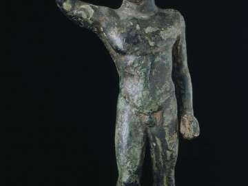 Statuette of victorious boxer
