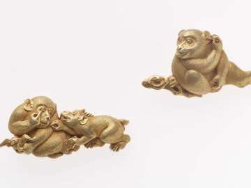 Pair of menuki each in the form of monkeys with fruit