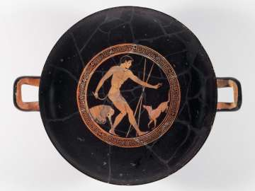 Drinking cup (kylix) depicting an athlete cleaning up and his dog
