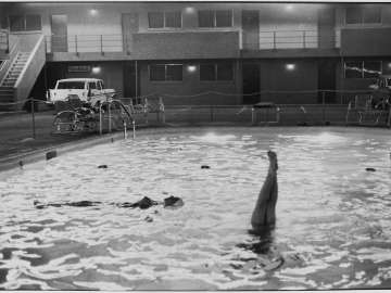 Untitled (Swimmers in swimming pool, one woman floating, another doing handstand) from the Women are Beautiful portfolio