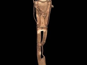 Male effigy cache figure