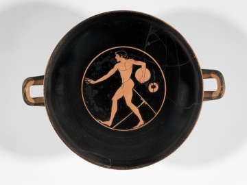 Drinking cup (kylix) depicting an athlete with discus