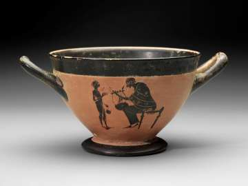 Drinking cup (skyphos) depicting young athlete taking a music lesson