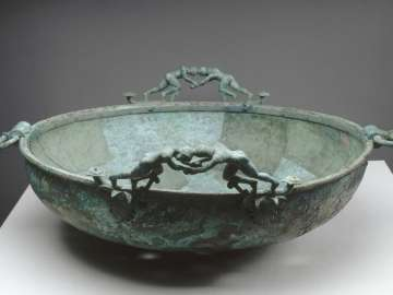 Large basin with wrestlers on its rim