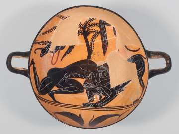 Drinking cup (kylix) depicting Herakles wrestling the Nemean lion