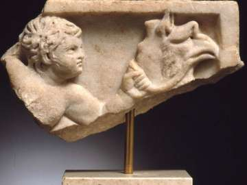 Fragment of sarcophagus lid with Eros riding a sea griffin