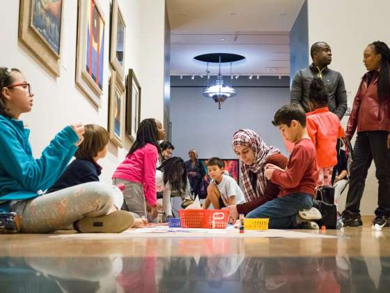 Kids doing art activity on floor of Lane Gallery