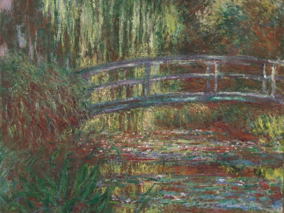 The Water Lily Pond, an oil painting of a small bridge over a pond by Claude Monet