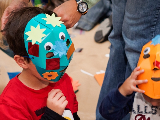Young visitors wearing brightly colored masks