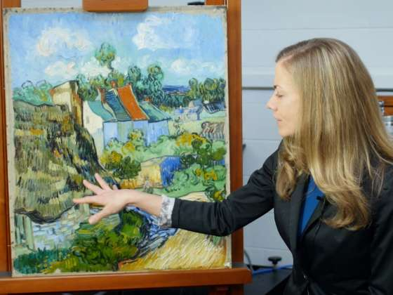 Curator points to Van Gogh painting on easel