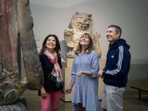 Three teachers looking at Guanyin sculpture