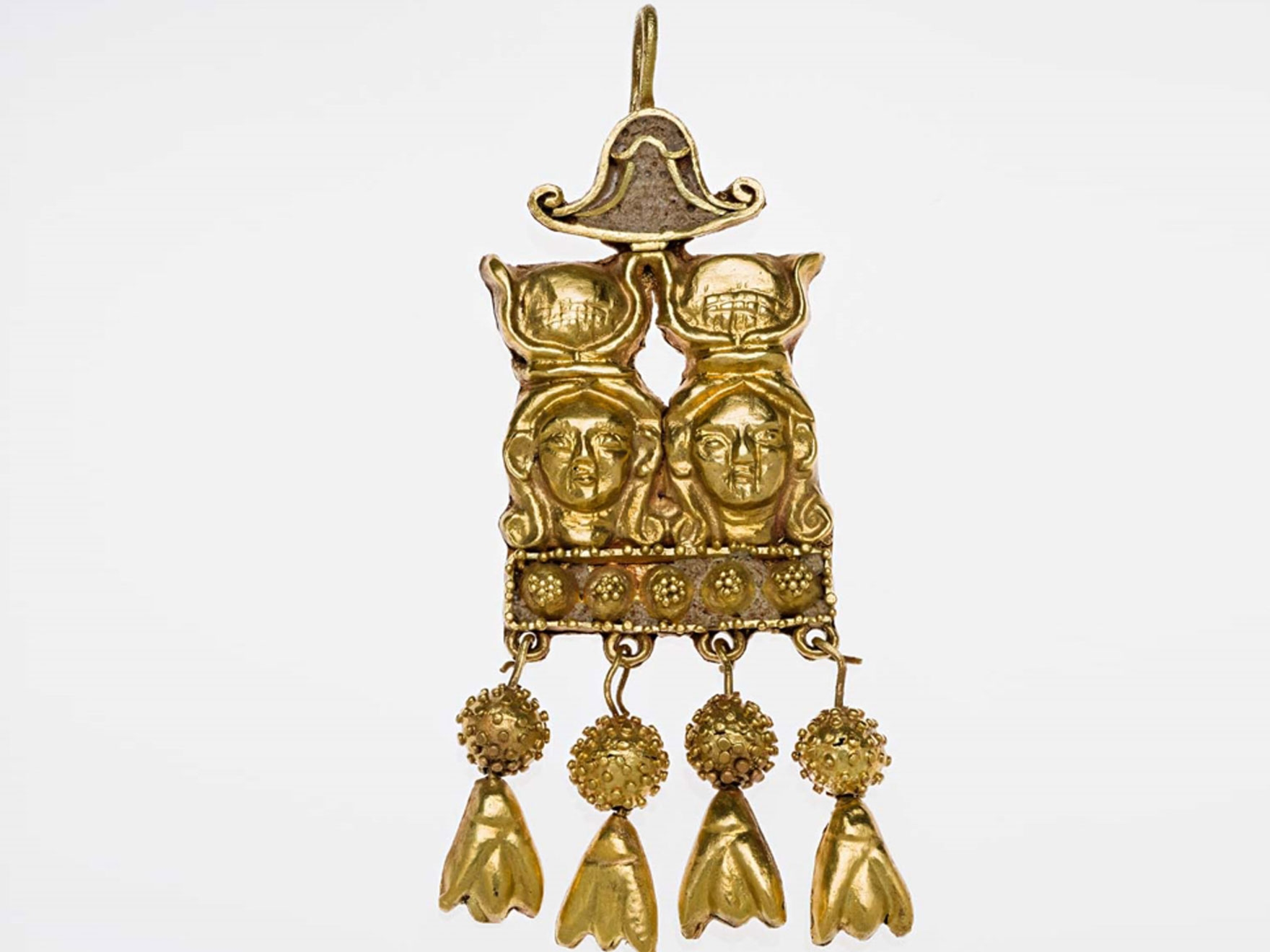 Nubian, gold earring depicting two heads of Hathor