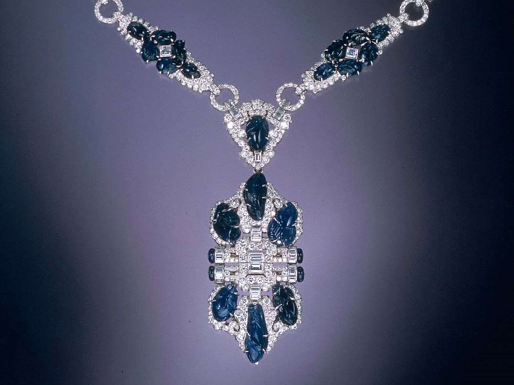 Platinum, engraved sapphire, and diamond necklace by Trabert & Hoeffer, Inc.-Mauboussin and worn by June Knight