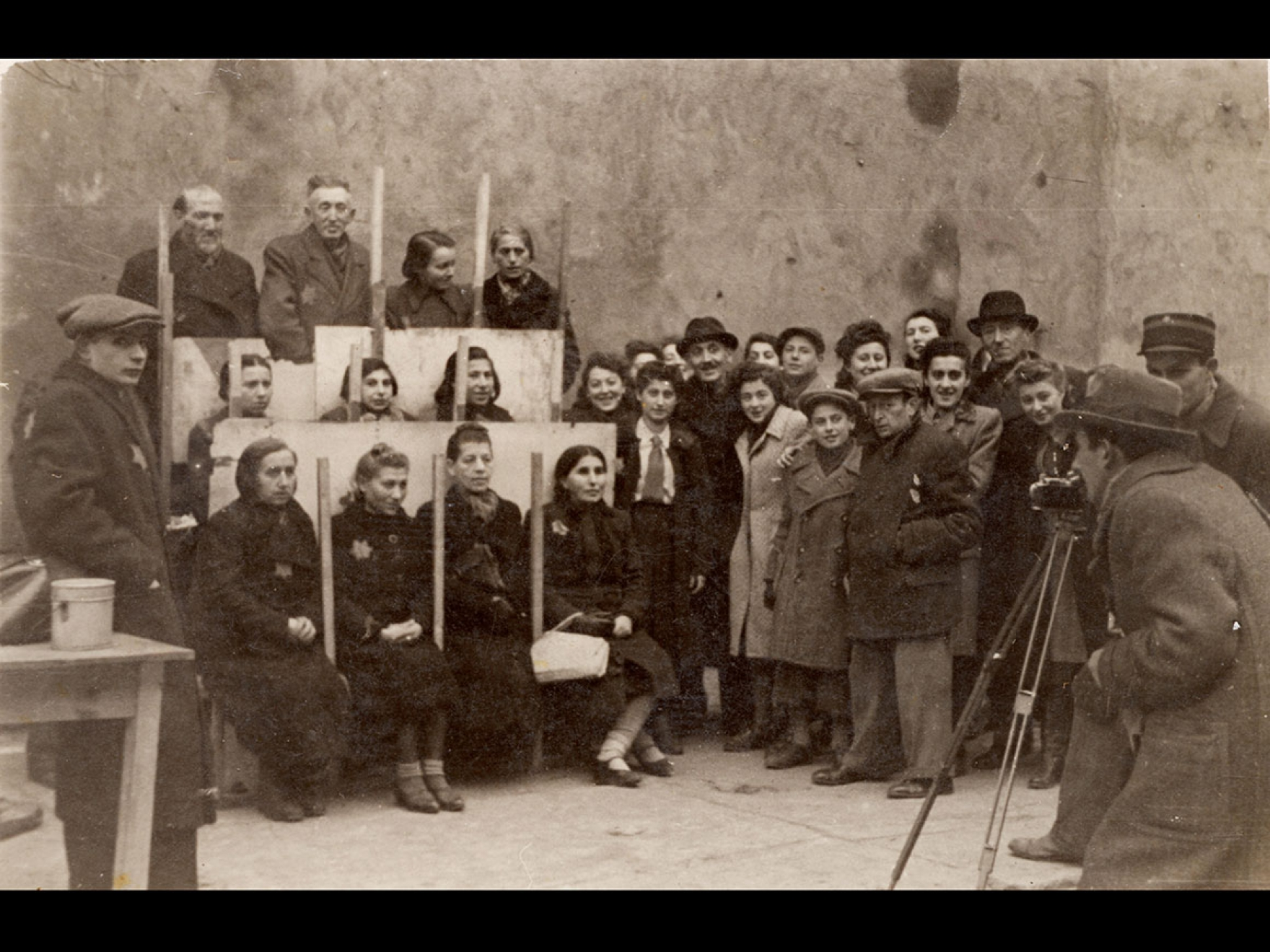 Photography of Henryk Ross photographing for identification cards, Jewish Administration, Department of Statistics, 1940