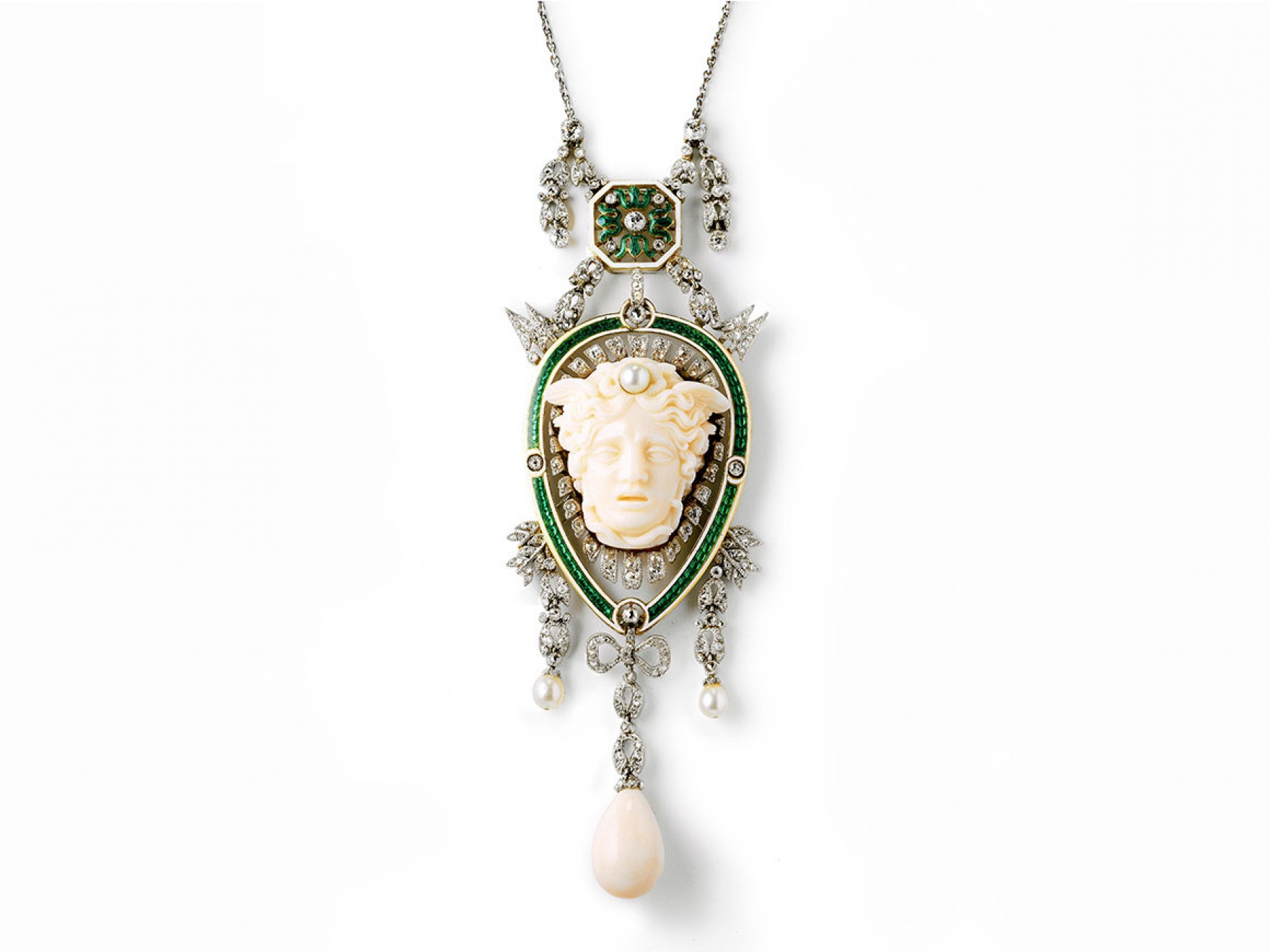 Cartier pendant with head of Medusa, made of platinum, gold, enamel, diamond, pearl, and coral.