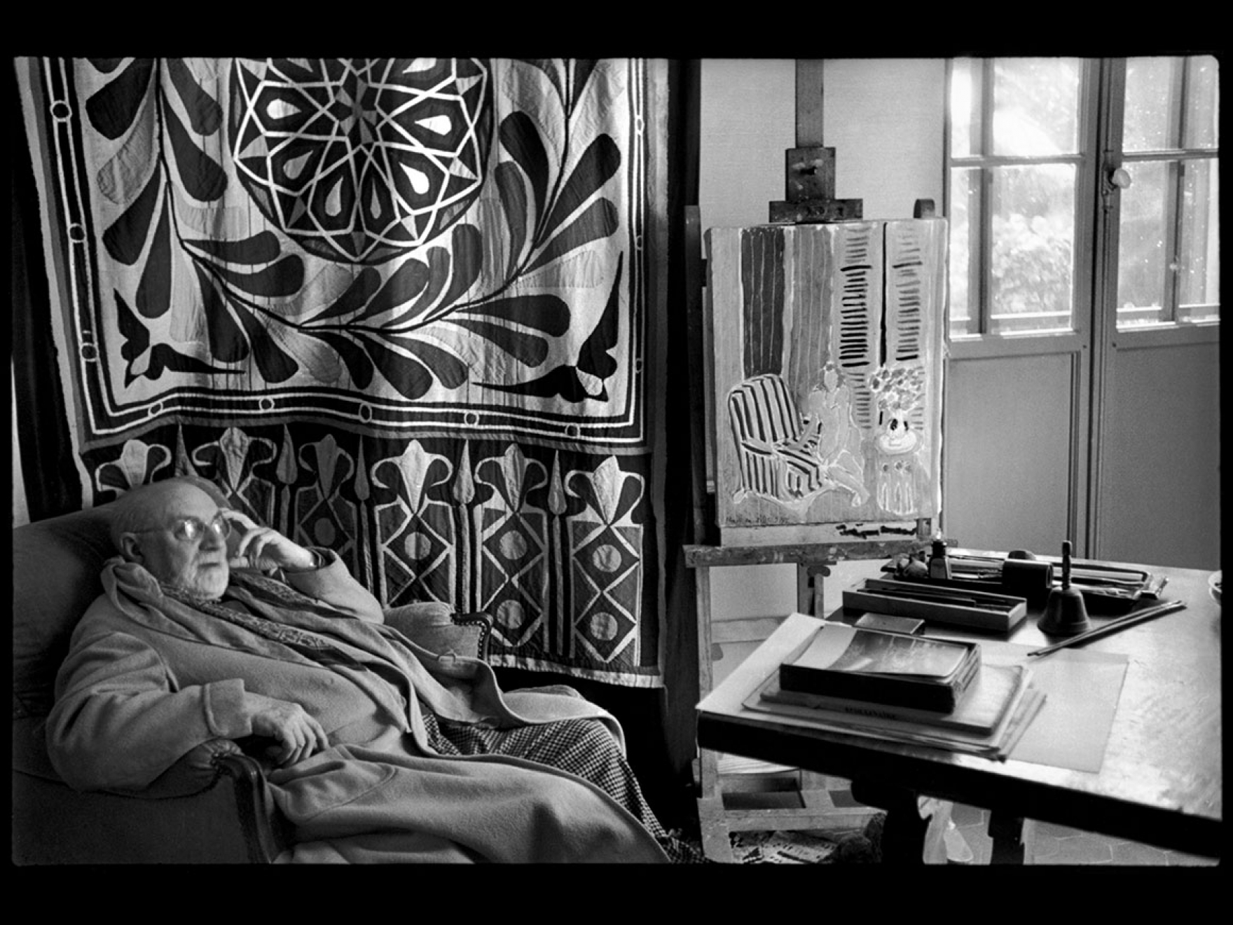 Henri Cartier-Bresson's photograph, Matisse at home in front of his Egyptian curtain, Villa Le Reve, Vence, 1944