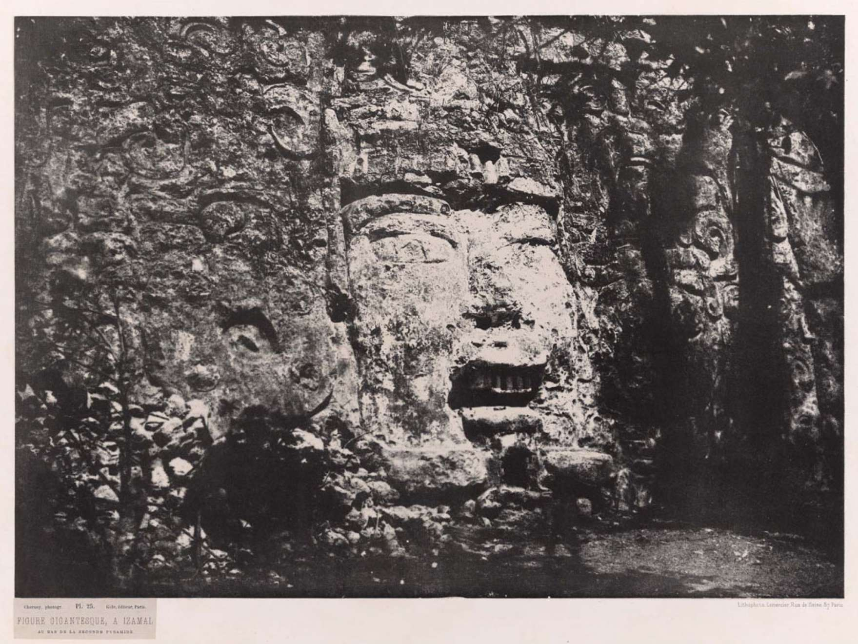 Désiré Charnay's Photolithograph of Colossal head at the base of a pyramid in Izamal, Mexico, 1860.